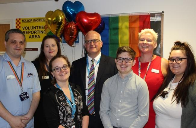 Transgender performance poet Jay Hulme (third right, front) with Trust staff