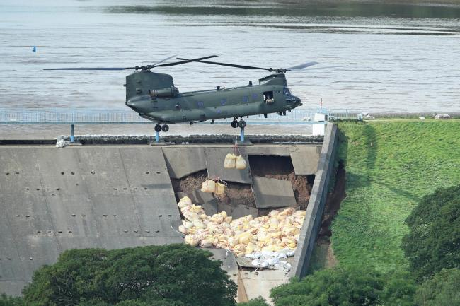 Damaged dam remains at 'critical level' as residents return home for