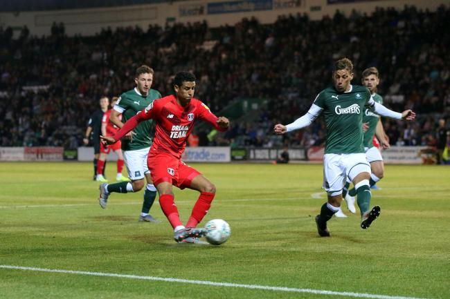 Leyton Orient's Louis Dennis goes up against Gary Sawyer in the Carabao Cup defeat to Plymouth Argyle. Picture: Simon O'Connor