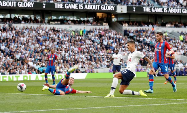 Victory cemented: Erik Lamela scores Spurs' fourth goal. Picture: Action Images