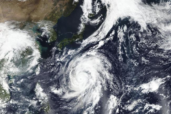 A photo taken by Nasa-NOAA's Suomi NPP satellite shows Typhoon Hagibis approaching Japan, top