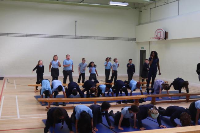 Montell Douglas put Hillyfield primary pupils through their paces