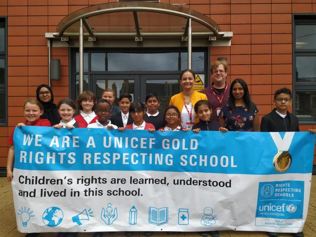 Siobhan Benita with pupils at Newport Primary School in Leyton, celebrating the school's 'gold' Unicef Rights Respecting School Award