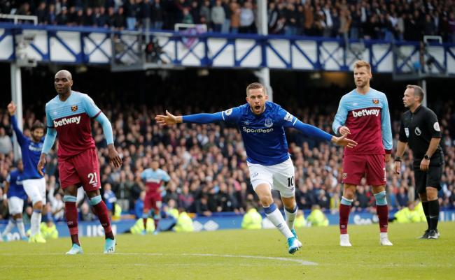 Fate sealed: Gylfi Sigurdsson celebrates scoring Everton's second goal. Picture: Action Images