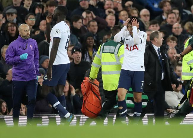 Son Heung-min and Serge Aurier react following the dreadful injury. Picture: Action Images
