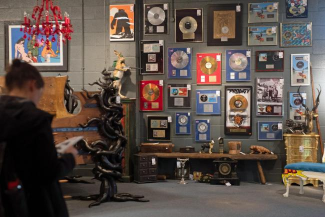 Keith Flint's gold and platinum selling albums and items of furniture on display at Cheffins auctioneers. Photo: Joe Giddens/PA Wire