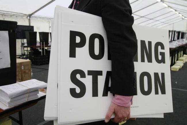 Ballot boxes and polling station signs..North London Business Park.New Southgate.NL20288.