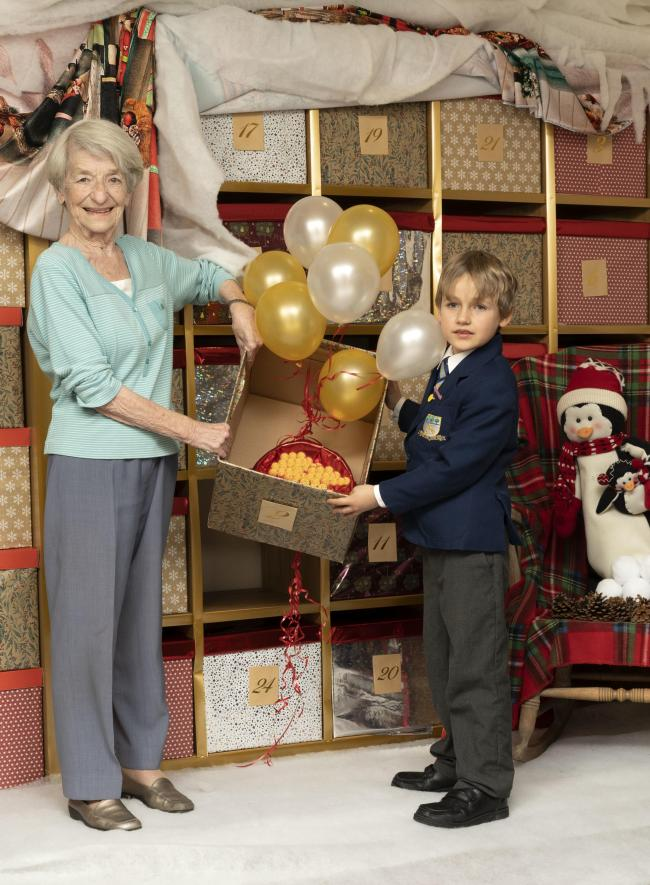 Vera Bowling and Freddie open the first door of the giant advent calendar.