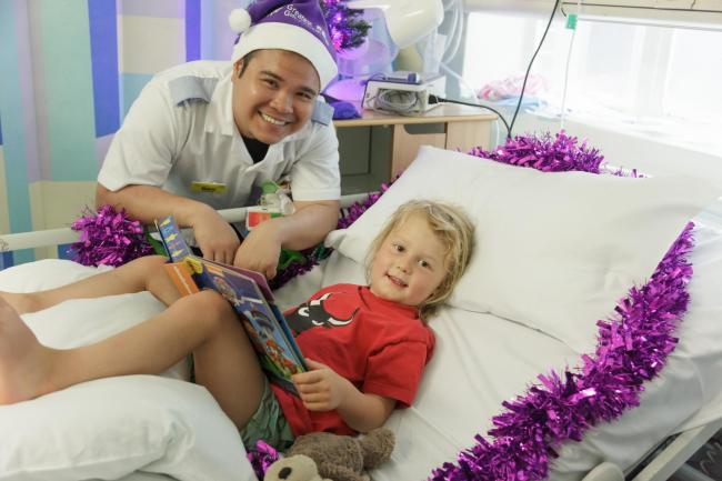 A child at Whipps Cross hospital is given a gift thanks to last year's Christmas appeal.
