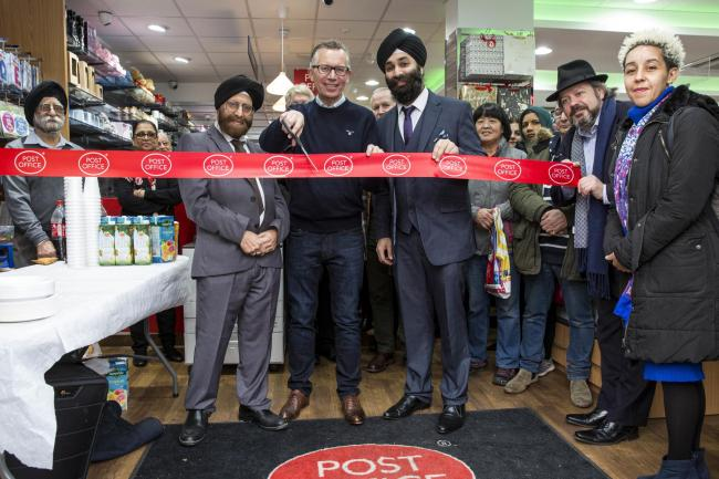 Wood Street Post Office opened last week. Left to right branch manager, Aman Sadana, Simon Phillips and Iqbal Aman.