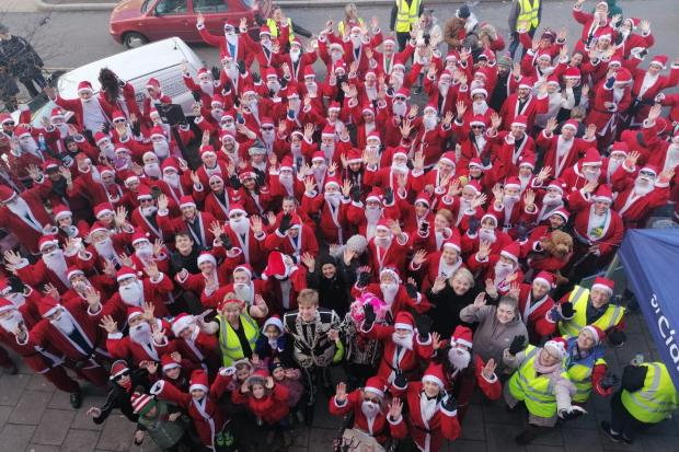 Almost 200 people dressed as Santa turned out in Debden to raise money for St Clare Hopsice