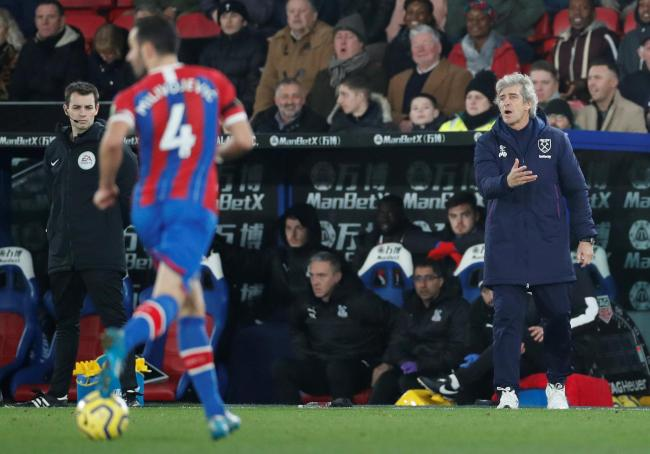 Manuel Pellegrini passes on instructions at Selhurst Park. Picture: Action Images