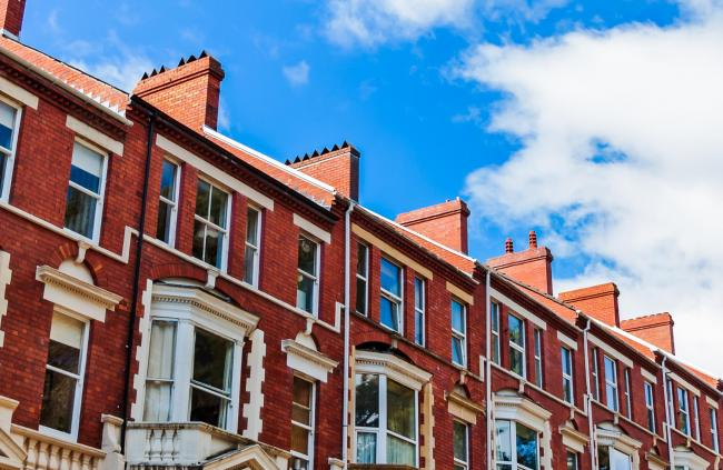 Row of typical British brownstone Terraced Houses with front garden in South Wales..