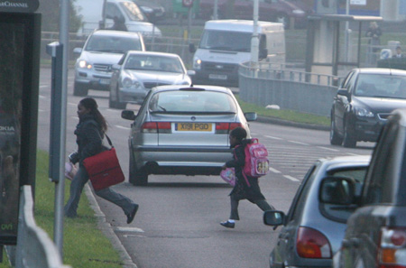 WOODFORD GREEN: Parents call for crossing on 'dangerous' road