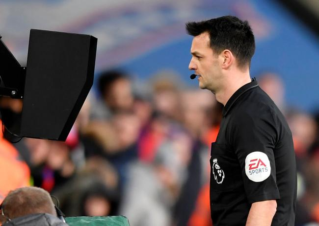 Referee Andy Madley refers to the VAR monitor. Picture: Action Images
