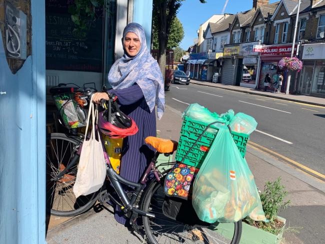 A resident collects food from the Hornbeam Centre and Cafe in Walthamstow.