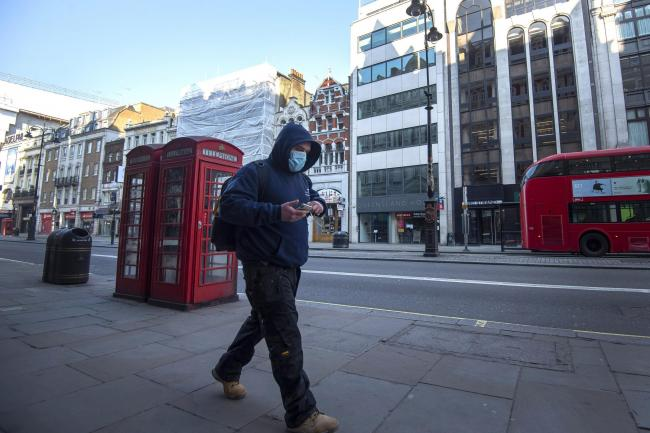 A man wearing a protective face mask during rush hour on the Strand in Westminster, London after Prime Minister Boris Johnson put the UK in lockdown to help curb the spread of the coronavirus. PA Photo. Photo: Victoria Jones/PA Wire