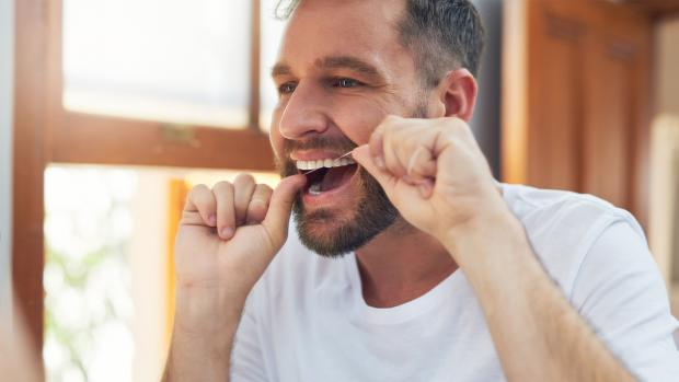 East London and West Essex Guardian Series: Find a flossing technique that you can stick to. Credit: Getty Images / People Images