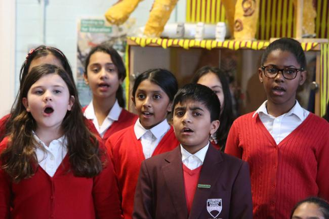 The school choir sing at the opening of the new extension connecting upper and low schools at Redbridge Primary School Redbridge. (19/1/2017) EL90247_4.