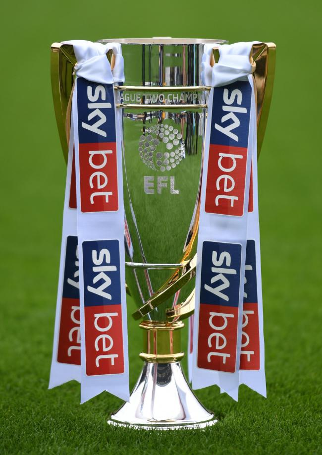 The League Two trophy will be handed to Swindon. Picture: PA Wire