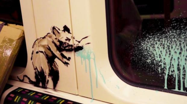 East London and West Essex Guardian Series: Banksy's sneezing rat reminds us of the dangers of passing on the virus on public transport (Photo: Banksy).