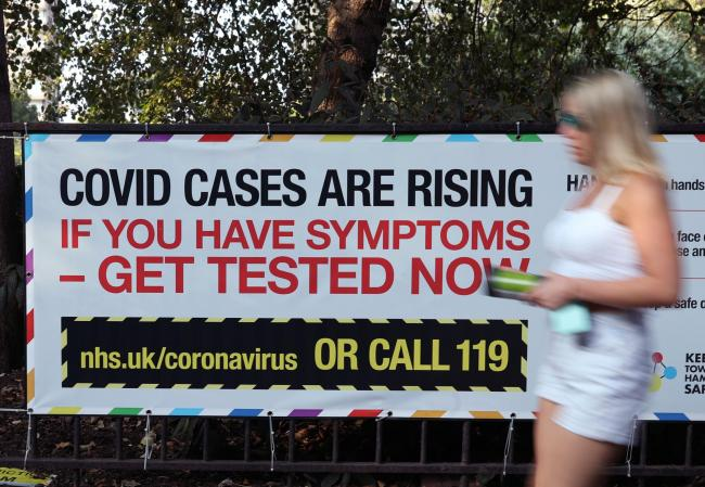 A public information sign warning of rising Covid-19 cases in London after Prime Minister Boris Johnson announced a range of new restrictions to combat the the coronavirus outbreak in England.