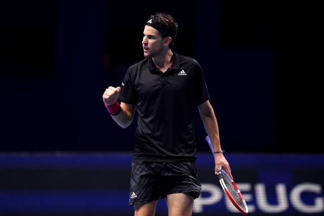 Dominic Thiem celebrates after beating Novak Djokovic at The O2
