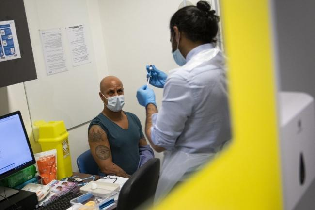 Frontline healthcare workers have began receiving the Covid vaccine. Credit: PA