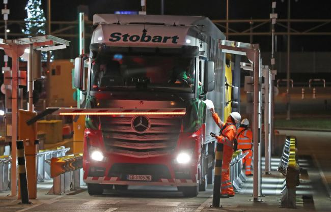 The first lorry, driven by Slavi Ivanov Shumeykov, loads onto Le Shuttle at the Eurotunnel in Folkestone, Kent, after the UK left the single market. Credit: PA