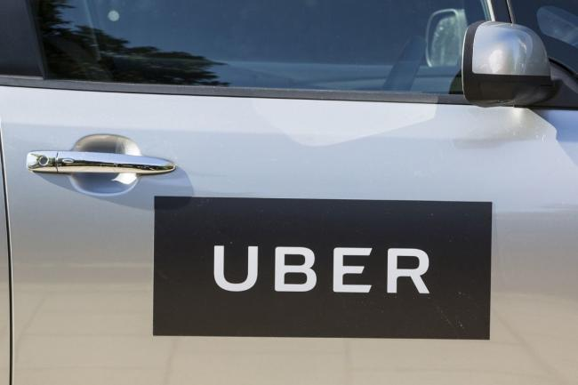 The Supreme Court today ruled that ride sharing app Uber must classify its workers as employees rather than self-employed. Credit: PA