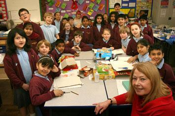 Liz Barrett (headteacher) with children at Nightingale Primary School.