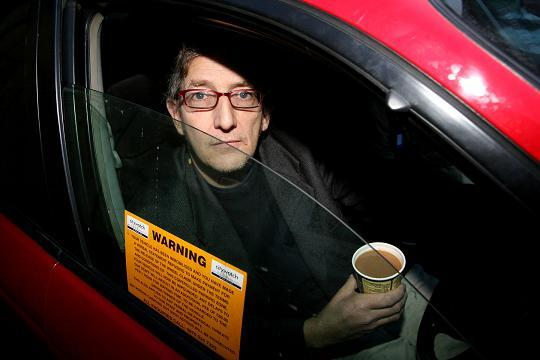 Nicholas Taylor protesting in his car against clampers City Watch