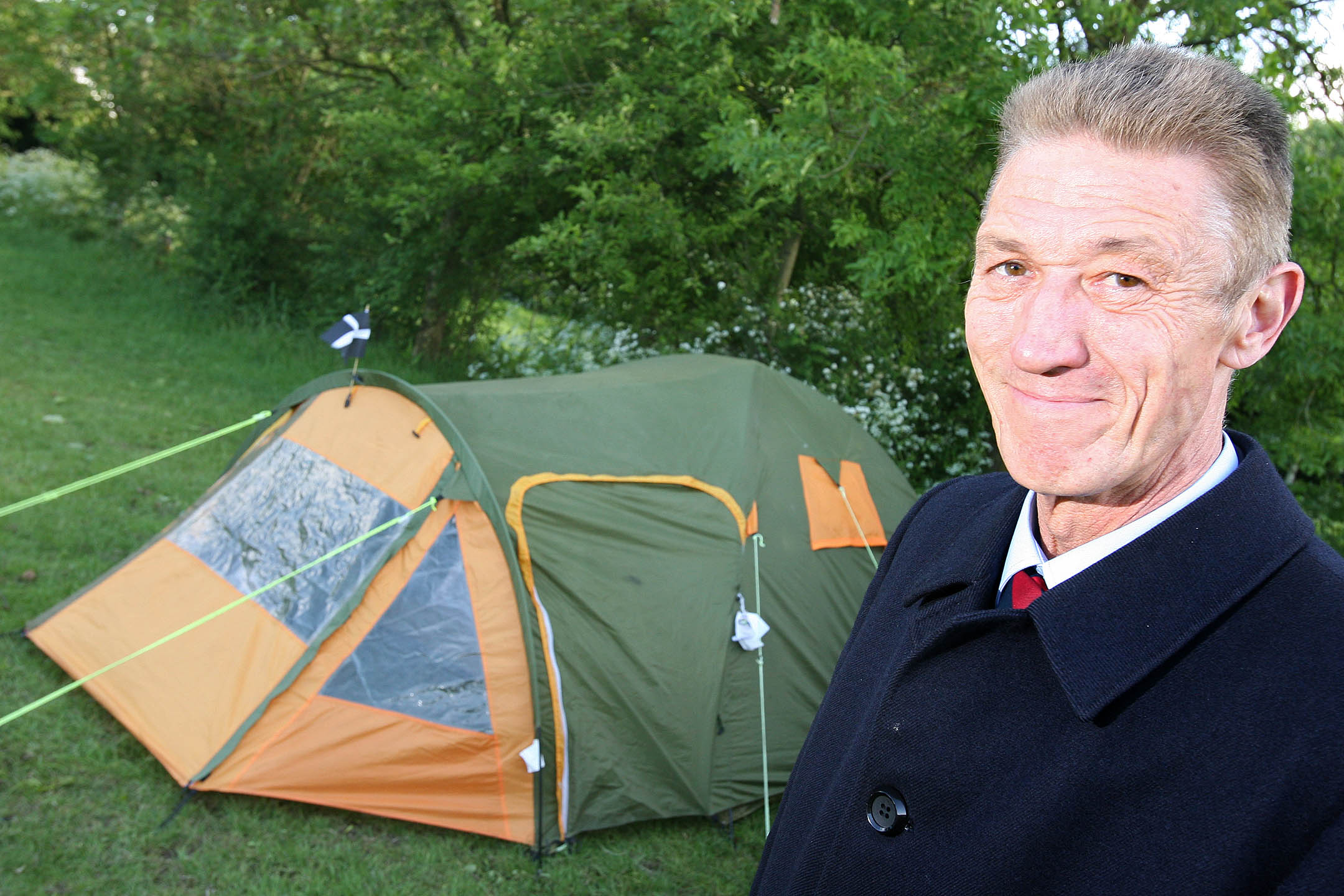 Philip Hanman by his tent in Epping Forest
