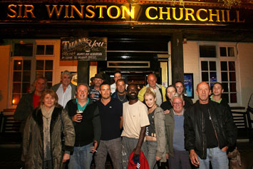 Landlord James Cosentino (front row third from left) and regulars at the Sir Winston Churchill pub