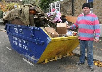 Dale Oseman with the council boxes in his skip