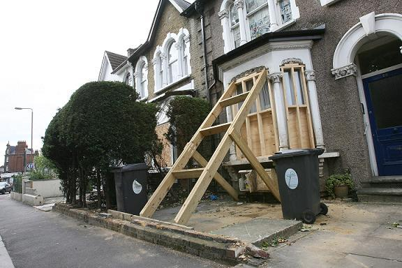 Damage to a house in Blackhorse Road after the crash.
