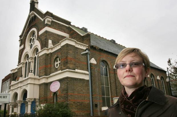 East London and West Essex Guardian Series: Reverend Eleanor Jackson standing outside Cambridge Park Methodist Church, Wanstead.