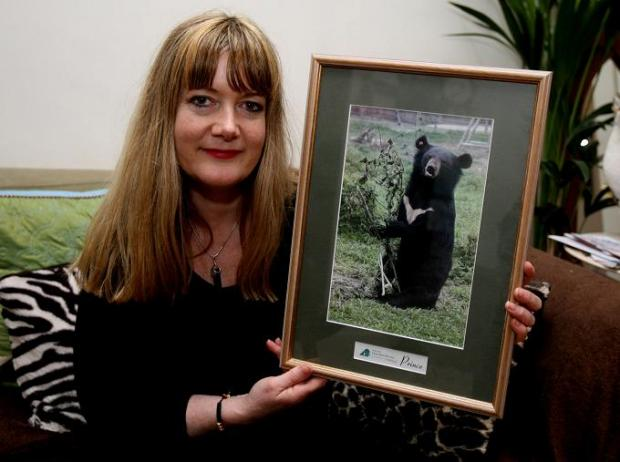 Jane Bailes with a picture of a moonbear for which she has cared