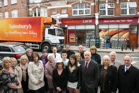 East London and West Essex Guardian Series: MP Iain Duncan Smith with campaigners outside Sainsbury's in The Broadway