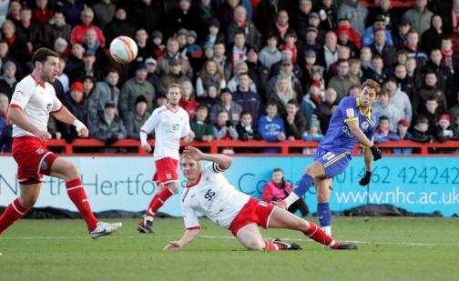 Lee Cook strikes the winning goal for the O's against Stevenage. Picture: Simon O'Connor