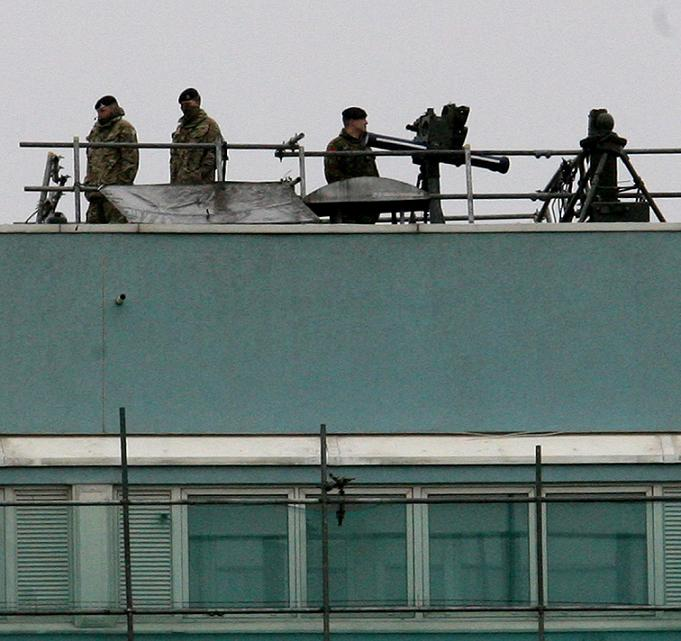 Soldiers on top of Fred Wigg Tower during an Olympics military exercise.