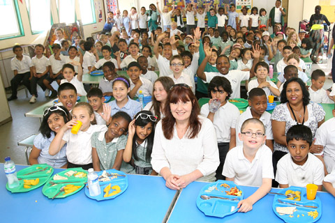 Head teacher Paulette Houghton and children who must squeeze into tiny dining hall at Thorpe Hall Primary School finally get some good news