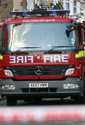 Pensioner rescued from flat fire