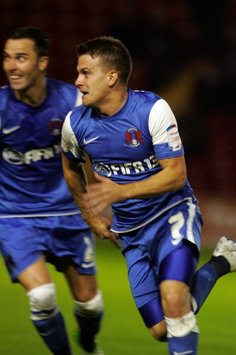 Dean Cox celebrates after his wonder strike: Simon O'Connor