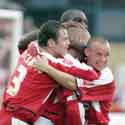 GOAL-DEN BOY: Double O's scorer Gary Alexander is mobbed (c)