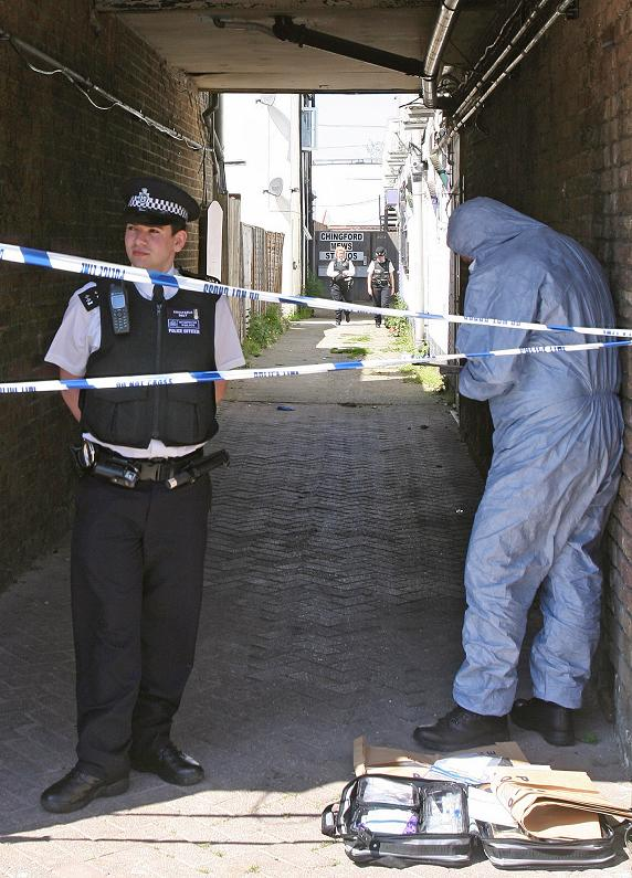 Police investigating one of the crime scenes following the bloody incident in May.
