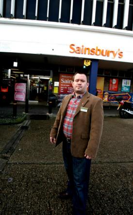 Cllr Leon Girling outside the Debden branch of Sainsbury's