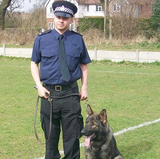 Pc Kieron Davies and his sidekick Tito tracked two robbers following reports the