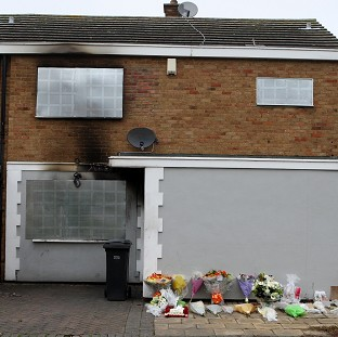 Floral tributes were left outside the property in Harlow, Essex, after the deaths of a mother and her five children in a fire