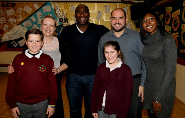 Sol Campbell with pupils Albert Purssord and Holly Richards, headteacher Kate Jennings, deputy head Andy Bocchi and governor Cllr Bernadette Mill.